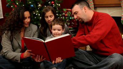 family reading, fire, Christmas, Grammarly